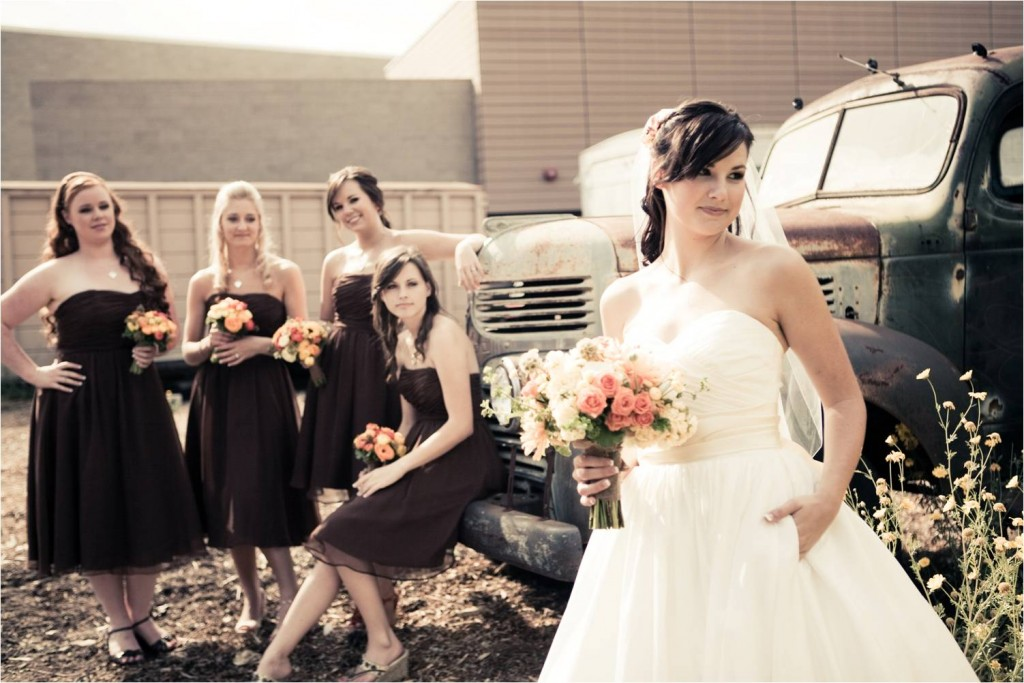 bride-in-white-strapless-ballgown-wedding-dress-poses-outside-with-bridesmaids-in-chocolate-brown-bridesmaids-dresses.original